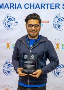 Jose Burgos posing with his SportsEngine Coaching Award.