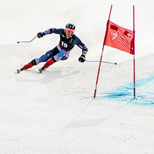 Tyler Carter downhill skiing during a competition.
