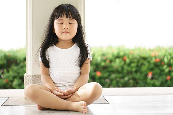 Young asian girl meditating alone.