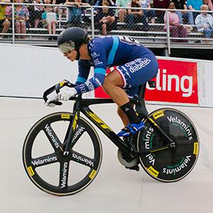 Mandy Marquardt riding in a track cycling competition.