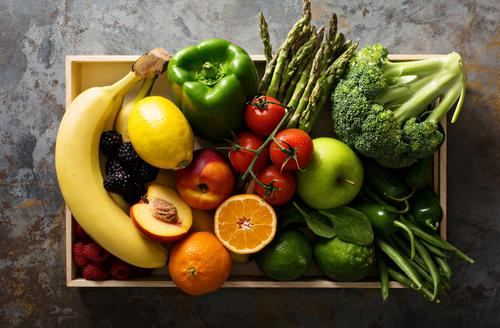 Basket full of fruits and vegetables.