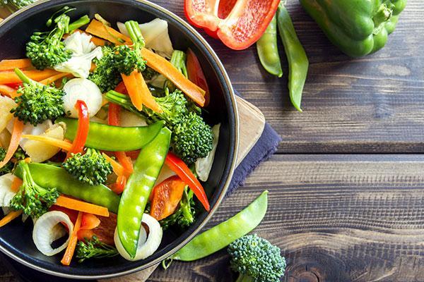 A bowl of stir fried vegetables.