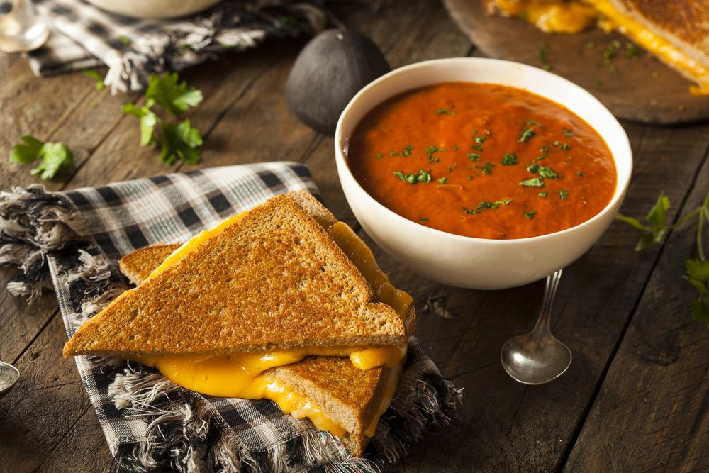 Grilled cheese and a bowl of tomato soup.