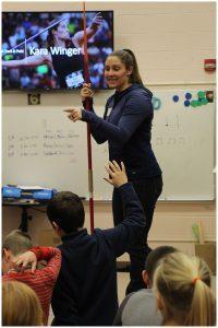 Kara Winger giving a presentation to elementary school children.