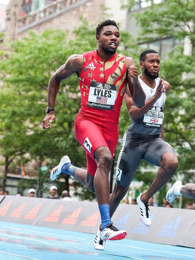 Noah Lyles sprinting in a race
