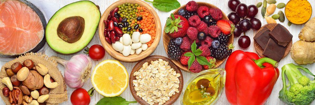 Overhead view of healthy fruits, vegetables, and nuts and fish.