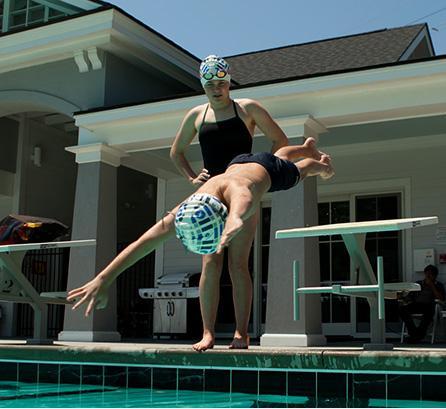 usa swimming kid diving into pool