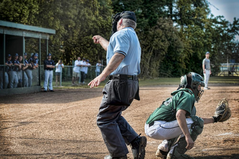 Umpire in youth baseball game making a call.