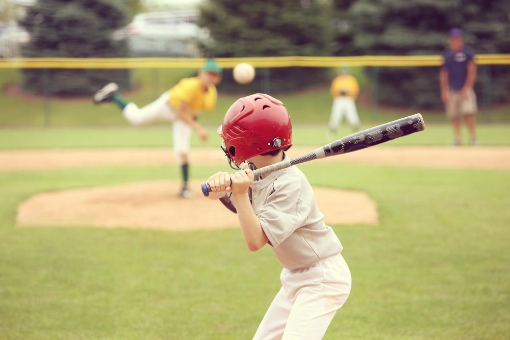 Young boy at bat during baseball game.