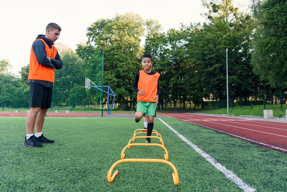Young male soccer player training.