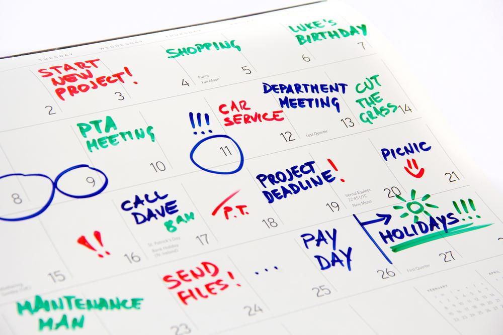 Calendar with most days filled out in various colors and activities.