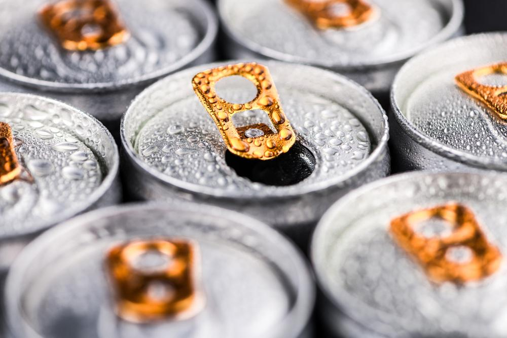 Top of energy drinks cans close up.
