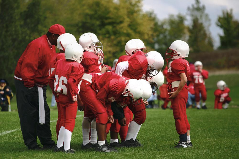 Peewee football team with coach.