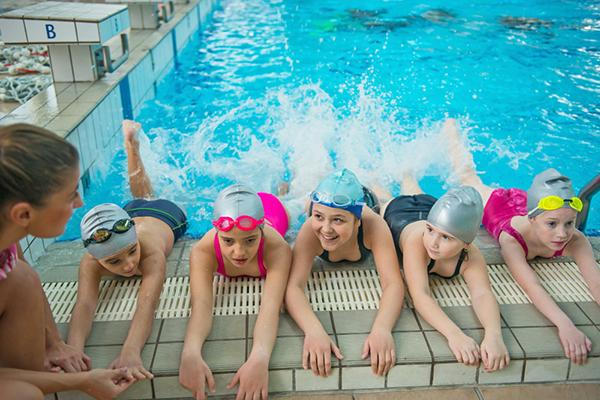 Small group of young girls during swim class.