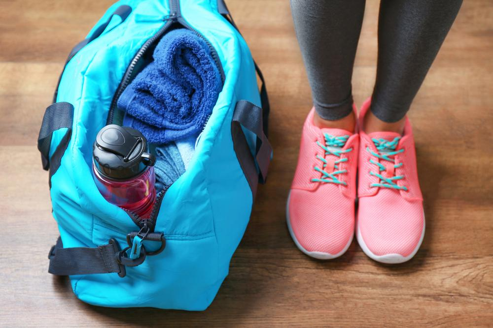 Close up shot of gym shoes and gym bag.