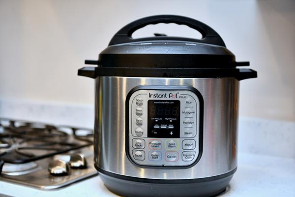 An Instant Pot next to a stove.