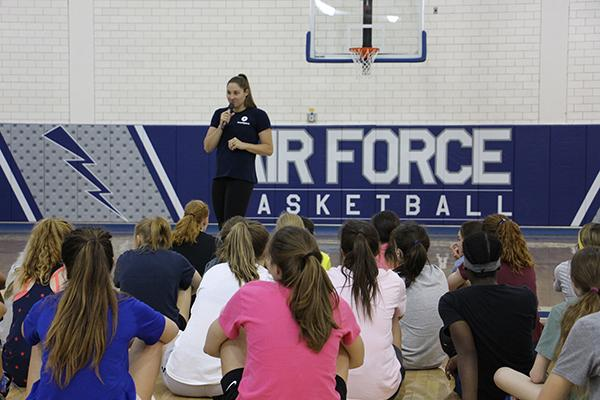 Kara Winger talking to young female basketball athletes.