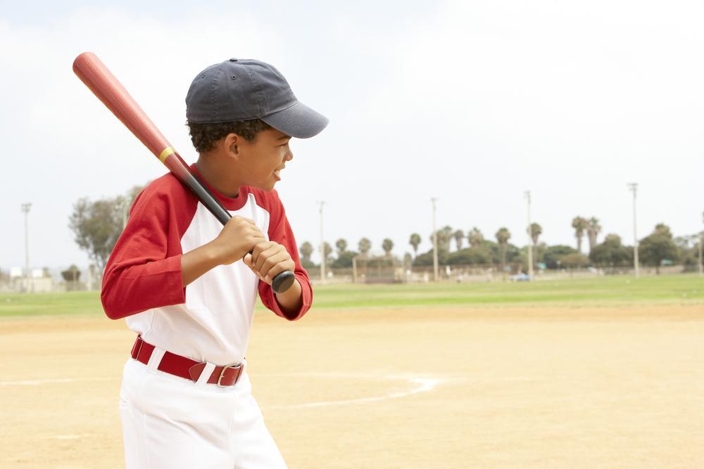 Young black kid playing baseball.