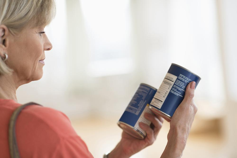 Woman reading nutrition labels.