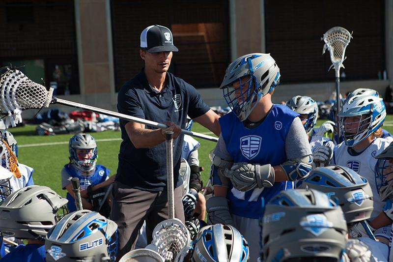 Trevor Tierney coaching his lacrosse team.