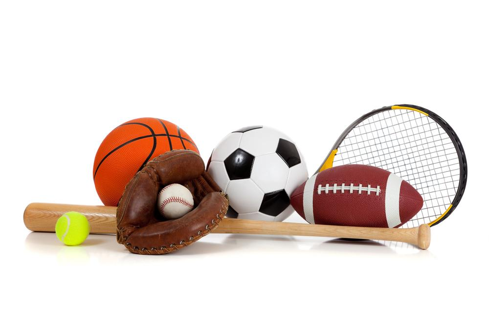 Multiple different sports equipment on white background.