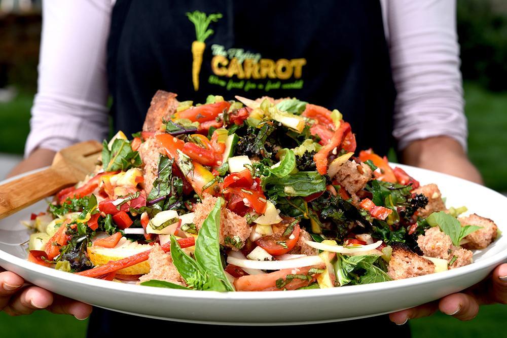 Panzanella salad on large plate.