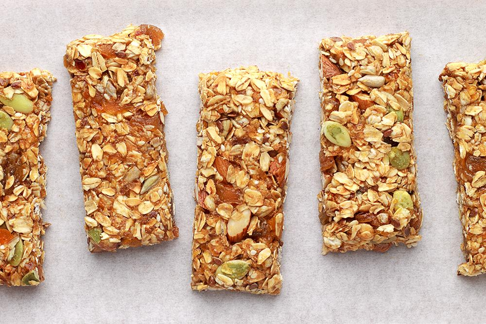 Granola bars on a white table.