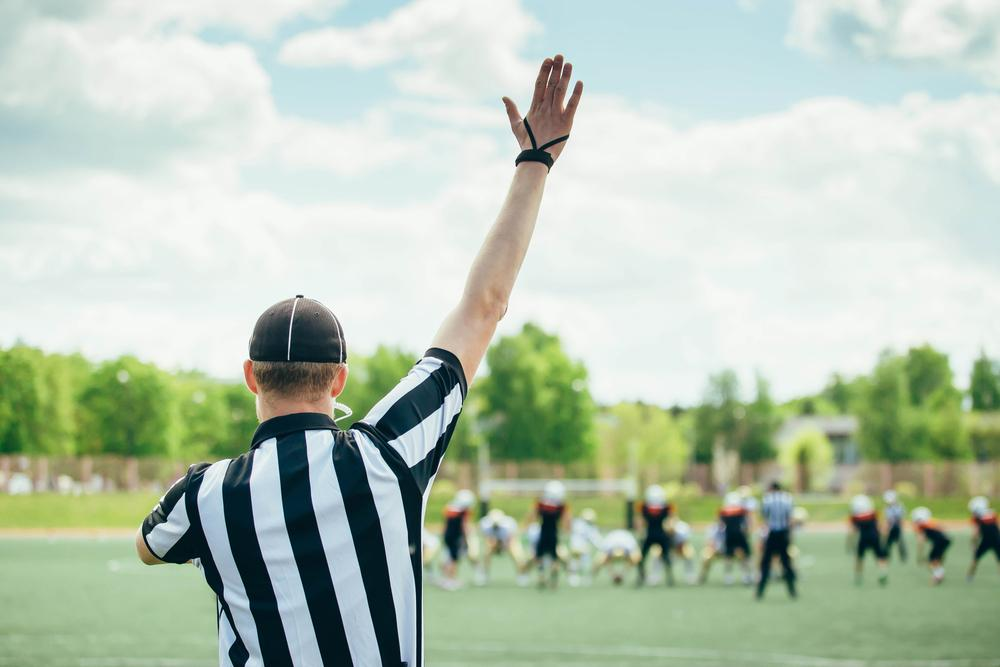 Referee with raised hand.