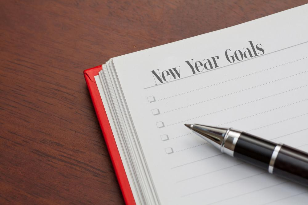 """Journal that has """"New Years Goals"""" written at the top of the page."""