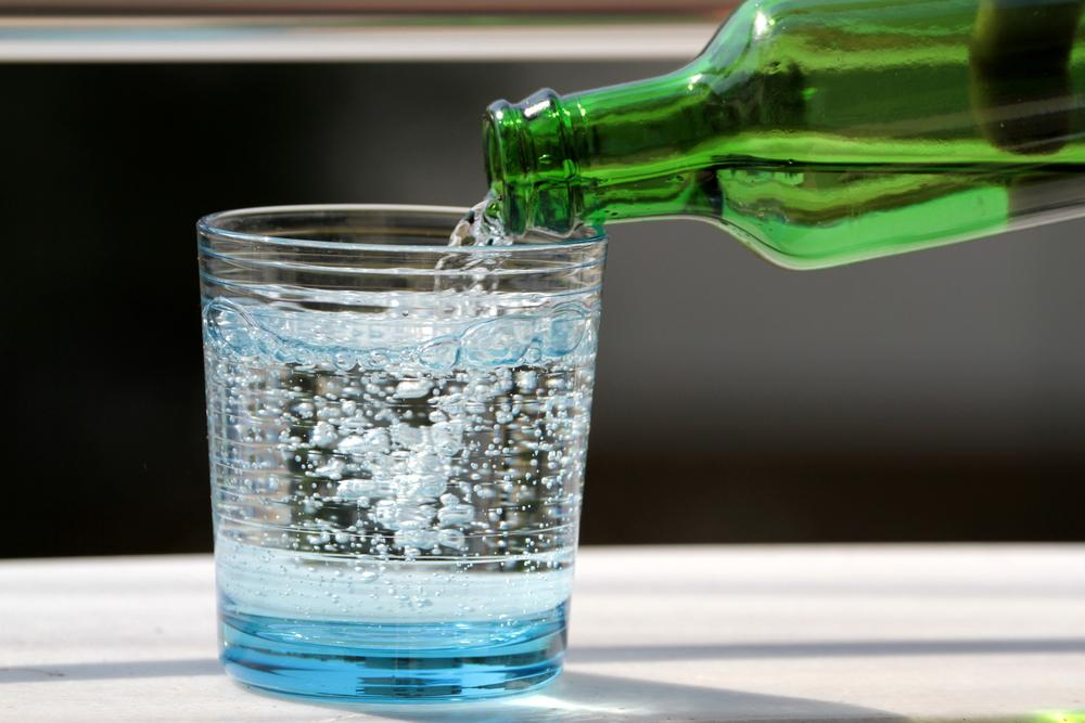 Seltzer water being poured into a glass.