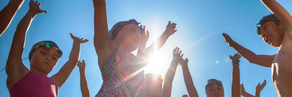 swimmers raising hands