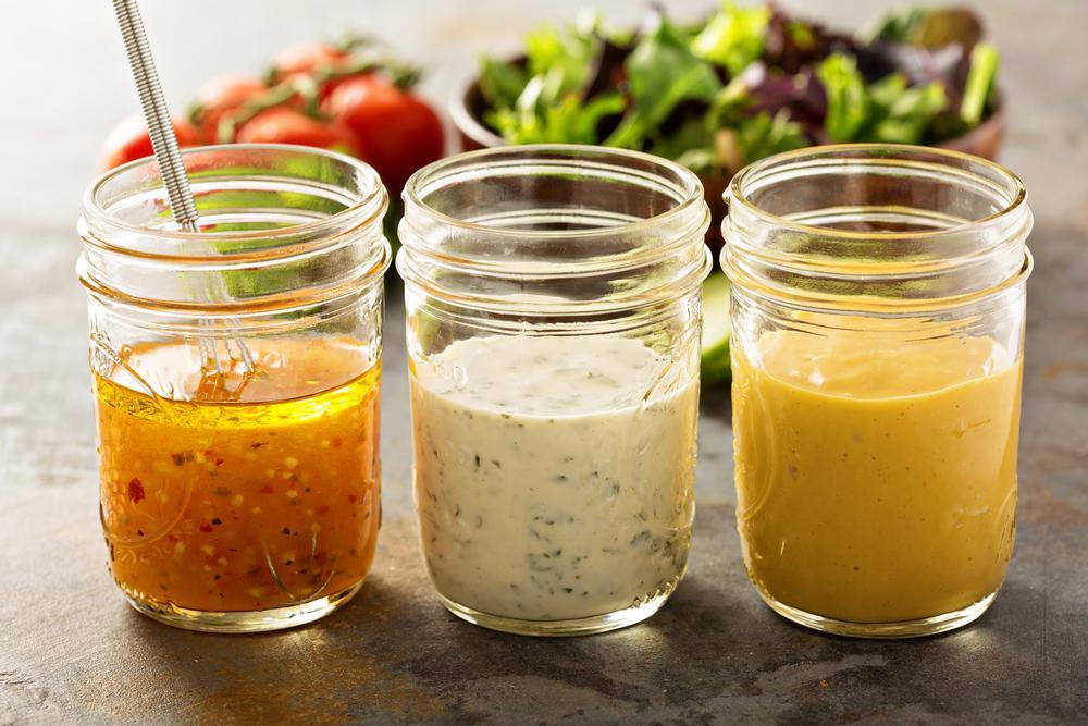Jars of different kinds of salad dressing.